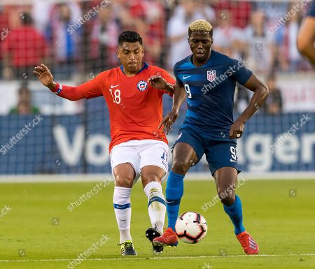USA forward Gyasi Zardes (9) and Chile defender Gonzalo Jara (18) battles for the ball during the second half of the international friendly match between USA and Chile at BBVA Compass Stadium in Houston, Texas The final ends in a tie 1-1