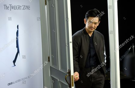 """John Cho walks through a doorway as he arrives at the Los Angeles premiere of """"The Twilight Zone"""" at Harmony Gold on"""