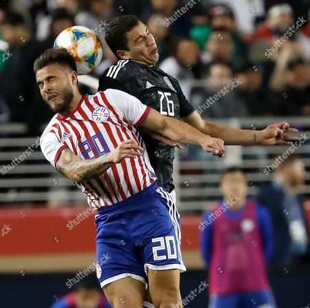 Hector Villalba of Paraguay (L) and Jorge Sanchez of Mexico (R) in action during the second half of the international friendly soccer match between Mexico and Paraguay at the Levi's Stadium in Santa Clara, California, USA, 26 March 2019.