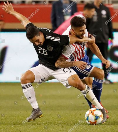 Jorge Sanchez of Mexico (L) and Hector Villalba of Paraguay (R) in action during the second half of the international friendly soccer match between Mexico and Paraguay at the Levi's Stadium in Santa Clara, California, USA, 26 March 2019.
