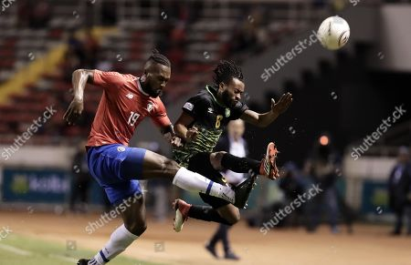 Kendall Waston (L) of Costa Rica vies for the ball against Malalique Foster (R) of Jamaica during a international friendly soccer match between Costa Rica and Jamaica, in San Jose, Costa Rica, 26 March 2019.