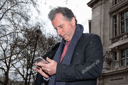 Sir Oliver Letwin MP leaves after appearing on a radio interview in Westminster this morning. Later today MPs are expected to vote on a series of indicative votes on alternative proposals to British Prime Minister Theresa May's withdrawal agreement.