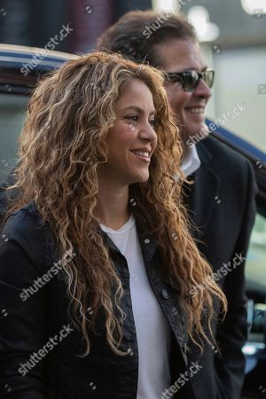"Colombian singers Shakira, left, and Carlos Vives, right, arrive at court in Madrid, Spain, . Colombian singers Shakira, right, and Carlos Vives, background, arrive at court in Madrid, Spain, Wednesday, March 27, 2019. Colombian singers Shakira and Carlos Vives have appeared in a Madrid court to answer allegations by a Cuban-born singer and producer that they plagiarized his work in their award-winning music hit ""La Bicicleta"