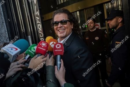 "Colombian singer Carlos Vives talks to journalists, not pictured, while arriving at court in Madrid, Spain, . Colombian singers Shakira, right, and Carlos Vives, background, arrive at court in Madrid, Spain, Wednesday, March 27, 2019. Colombian singers Shakira and Carlos Vives have appeared in a Madrid court to answer allegations by a Cuban-born singer and producer that they plagiarized his work in their award-winning music hit ""La Bicicleta"