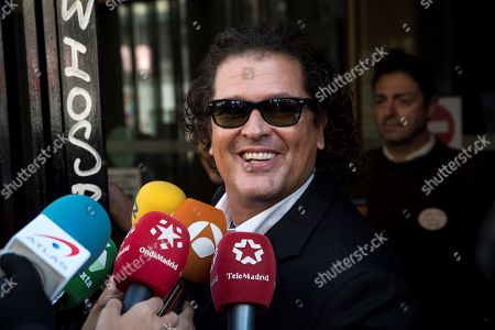 Colombian singer and defendant Carlos Vives talks to the media as he arrives at the Number 12 Commercial Court alongside Colombian singer Shakira (unseen) for the first day of a trial of alleged plagiarism, in Madrid, Spain, 27 March 2019. Cuban singer Livan Castellano Valdes (unseen) sued Shakira for allegedly plagiarizing some extracts of his song 'Yo te quiero tanto' (lit. 'I Love You So Much') from 1997 in Shakira's song 'La bicicleta' (The bicycle) featuring Colombian singer Carlos Vives.