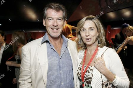 Stock Picture of Pierce Brosnan and France Chretien Desmarais of One Drop