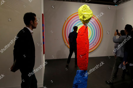 """An artwork """"Blue red yellow mountain"""" created by Swiss artist Ugo Rondinone is displayed at Art Basel in Hong Kong . Art Basel, one of the world's most prestigious modern and contemporary art exhibitions, is returning to Hong Kong in its seventh edition. The prestige art fair is hosting 242 galleries from 35 countries and territories"""