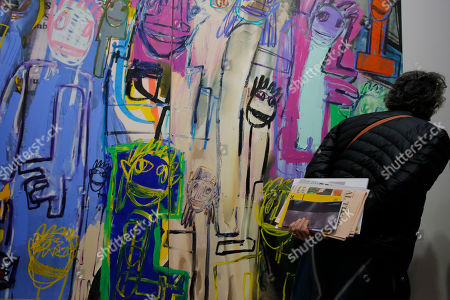 """Stock Photo of A visitor looks at an artwork """"Untitled"""" created by American artist Richard Prince at Art Basel in Hong Kong . Art Basel, one of the world's most prestigious modern and contemporary art exhibitions, returned to Hong Kong in its seventh edition. The prestige art fair is hosting 242 galleries from 35 countries and territories"""
