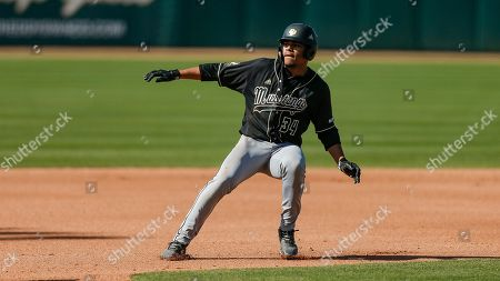 Cal Poly freshman Noah Taylor is caught in a run down during an NCAA college baseball game against Baylor, in Waco, Texas. Cal Poly won 3-1