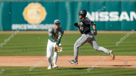 Baylor senior second baseman Josh Bissonette (14) fields a hit as Cal Poly freshman Noah Taylor (34) runs to second during an NCAA college baseball game, in Waco, Texas. Cal Poly won 3-1