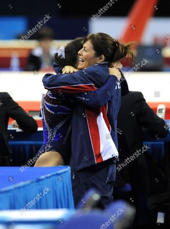Stock Photo of Elizabeth Tweddle of Great Britain hugs her coach Amanda Kirby after her Gold Medal winning routine in the Women's Floor Apparatus Final.
