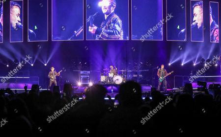 Matt Bellamy, Chris Wolstenholme, Dominic Howard. Matt Bellamy, Chris Wolstenholme and Dominic Howard with Muse performs at State Farm Arena, in Atlanta