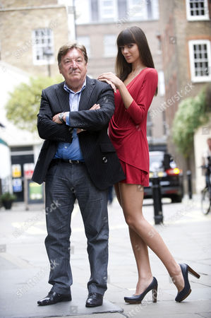 George Davies with a model wearing part of the new collection
