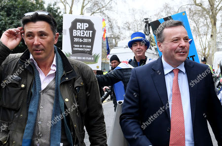 Ex-UKIP funder Arron Banks and his associate Andy Wigmore outside the Houses of Parliament