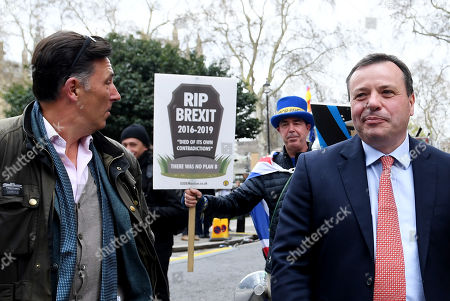 Stock Image of Ex-UKIP funder Arron Banks and his associate Andy Wigmore outside the Houses of Parliament
