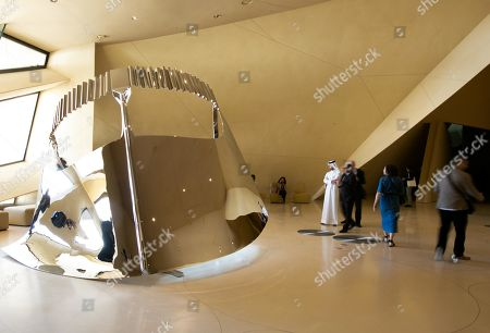 People stand at the National Museum of Qatar during a media tour on opening day in Doha, Qatar, 27 March 2019. The complex architectural form of a desert rose, found in Qatar's desert regions, inspired the striking design of the new museum building, conceived by French architect Jean Nouvel.