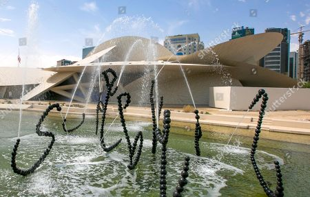 Stock Picture of An exterior view of National Museum of Qatar on the opening day in Doha, Qatar, 27 March 2019. The complex architectural form of a desert rose, found in Qatar's desert regions, inspired the striking design of the new museum building, conceived by French architect Jean Nouvel.