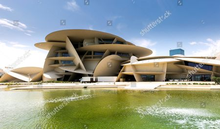 An exterior view of National Museum of Qatar on the opening day in Doha, Qatar, 27 March 2019. The complex architectural form of a desert rose, found in Qatar's desert regions, inspired the striking design of the new museum building, conceived by French architect Jean Nouvel.