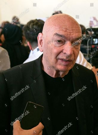 French architect Jean Nouvel speaks to media after a press conference at the National Museum of Qatar on it's opening day in Doha, Qatar, 27 March 2019. The complex architectural form of a desert rose, found in Qatar's desert regions, inspired the striking design of the new museum building, conceived by French architect Jean Nouvel.