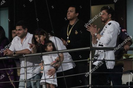 Co-owner and Bollywood actor Shah Rukh Khan, right, cheers for his team during the VIVO IPL cricket T20 match against Kings XI Punjab in Kolkata, India