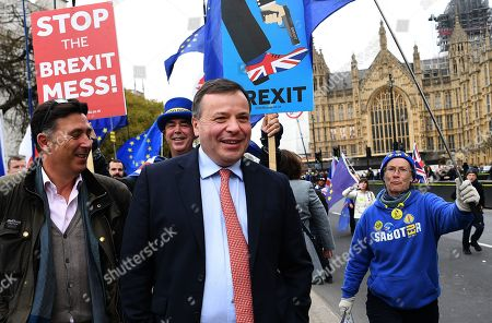 Co-founder of the Leave.EU campaign Arron Banks (C) is followed by 'Stop Brexit' campaigner Steve Bray (C-L) outside parliament in London, Britain, 27 March 2019. The British Houses of Parliament are due to hold a number of indicative votes on the direction of Brexit later in the day after voting on the 25 March 2019 to have a greater say in the direction of Brexit.