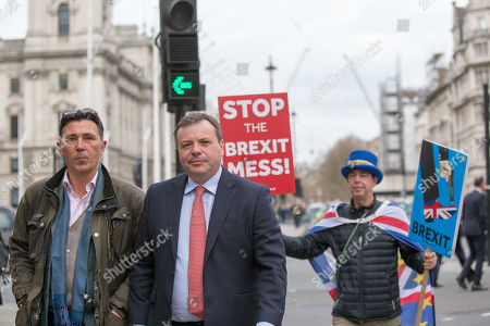 Andy Wigmore and Arron Banks leave the Houses of Parliament and speak to protesters. Steve Bray in background
