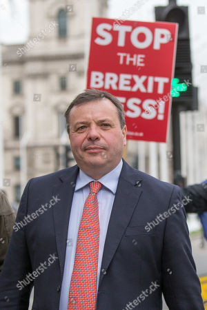 Arron Banks leaves the Houses of Parliament and speaks to protesters