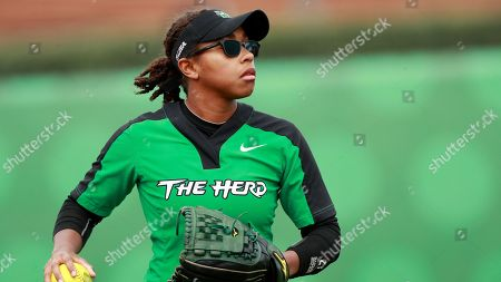 Marshall outfielder Chloe Lee fields a ball against the Charlotte 49ers during an NCAA softball game on in Charlotte, N.C