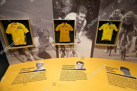 The yellow jersey of US rider Greg Lemond (L), French rider Louison Bobet (C) and British rider Christopher Froome (R) are on display during the exhibition '100 years Yellow Jersey' at the National Sport Museum in Nice, France, 27 March 2019. The exhibition runs from 17 March to 29 September 2019.