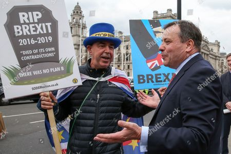 British businessman, Arron Banks speaks with Steve Bray, an anti-Brexit activist outside Houses of Parliament.