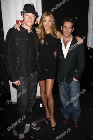 Stock Photo of Tahmoh Penikett, Tricia Helfer and James Callis