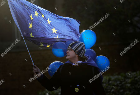 A Pro EU protestor demonstrates in front of the Houses of Parliament in London, . British lawmakers were preparing to vote Wednesday on alternatives for leaving the European Union as they seek to end a political impasse following the overwhelming defeat of the deal negotiated by Prime Minister Theresa May