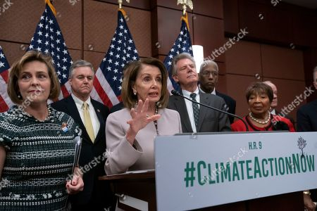 "Nancy Pelosi, Kathy Castor, David Trone, Frank Pallone, Donald McEachin, Eddie Bernice Johnson. House Speaker Nancy Pelosi, D-Calif., turns her party's attention to the climate crisis as she leads an event to introduce the ""Climate Action Now Act,"" which focuses on reducing carbon pollution, honoring America's Paris Agreement commitments, and lays the groundwork to expand clean energy, at the Capitol in Washington, . From left are, Rep. Kathy Castor, D-Fla., who will chair the House Select Committee on the Climate Crisis, Rep. David Trone, D-Md., Speaker Nancy Pelosi, House Energy and Commerce Chairman Frank Pallone, D-N.J., Rep. Donald McEachin, D-Va., and Science, Space and Technology Chairwoman Eddie Bernice Johnson, D-Texas"