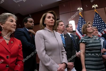 "Stock Image of Nancy Pelosi, Jan Schakowsky, Kathy Castor. House Speaker Nancy Pelosi, D-Calif., flanked by Rep. Jan Schakowsky, D-Ill., left, and Rep. Kathy Castor, D-Fla., right, who will chair the House Select Committee on the Climate Crisis, turns her party's attention to the climate crisis as she leads an event to introduce the ""Climate Action Now Act,"" which focuses on reducing carbon pollution, honoring America's Paris Agreement commitments, and lays the groundwork to expand clean energy, at the Capitol in Washington"
