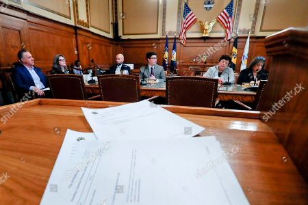 The agenda for the Pittsburgh City Council meeting is in front of council members, from left, Anthony Coghill, Deborah Gross, Robert Daniel Lavelle, Corey O'Connor, Darlene Harris and Theresa Smith as the council discusses a vote on gun-control legisation, in Pittsburgh. The bill passed as members voted 6-3 to pass tentative approval to gun-control legislation he co-sponsored was introduced in the wake of the synagogue massacre last October. The legislation would place restrictions on military-style assault weapons like the AR-15 rifle that authorities say was used in the attack that killed 11 and wounded seven. A final vote will take place next week