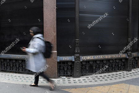 A pedestrian walks past George Attenborough and Sons jewellery store in London, Britain, 27 March 2019. A major police hunt is under way following a jewellery heist at a building owned by Lord Sugar. Thieves drilled through a ground floor wall of a jewellers in Fleet Street from a neighbouring bookshop. Some three millions pounds worth of jewels and watches were taken.
