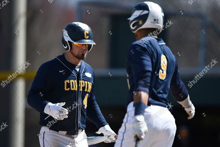 Stock Image of Coppin State's Derek Lohr, left, is congratulated by Matt Day after scoring during an NCAA college baseball game, in Hanover, Md