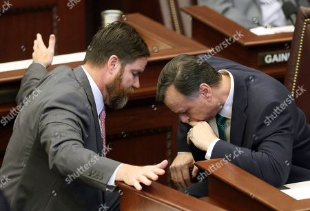 Senators Aaron Bean, R-Fernandina Beach, left, and Tom Lee, R-Brandon confer during session Wednesday, March, 27 2019, in Tallahassee, Fla