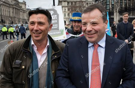 Brexit funder Arron Banks (R) walks outside Parliament with campaigner Andy Wigmore.