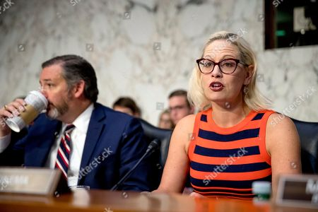 Ted Cruz, Kyrsten Sinema. Subcommittee Ranking Member Kyrsten Sinema, D-Ariz., right, accompanied by subcommittee Chairman Ted Cruz, R-Texas, left, speaks as Federal Aviation Administration Acting Administrator Daniel Elwell, National Transportation Safety Board Chairman Robert Sumwalt, and Department of Transportation Inspector General Calvin Scovel appear before a Senate Transportation subcommittee hearing on commercial airline safety, on Capitol Hill, in Washington