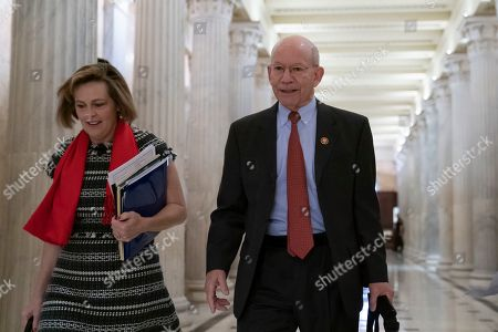 House Select Committee on the Climate Crisis Kathy Castor, D-Fla., left, and House Transportation and Infrastructure Committee Chair Peter DeFazio, D-Ore., walk through the Hall of Columns at the Capitol as House Democratic chairs gather for a meeting with Majority Leader Steny Hoyer, D-Md., in Washington