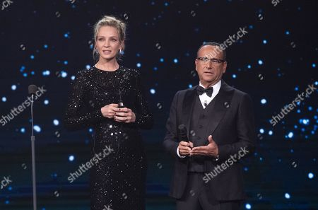 Uma Thurman and Italian presenter Carlo Conti (R) on stage in the occasion of the 64th edition of the David di Donatello Awards of the David di Donatello Awards in Rome, Italy, 27 March 2019. The David di Donatello award is a film prize presented annually to honor the best of Italian and foreign motion picture productions.