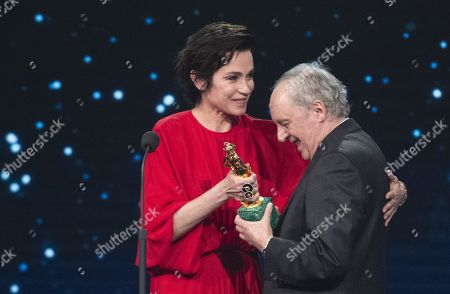 Dario Argento with Italian actress Stefania Rocca on stage in the occasion of the 64th edition of the David di Donatello Awards of the David di Donatello Awards in Rome, Italy, 27 March 2019. The David di Donatello award is a film prize presented annually to honor the best of Italian and foreign motion picture productions.