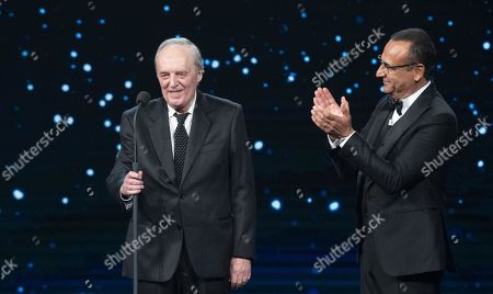 Dario Argento with Italian presenter Carlo Conti (R) on stage in the occasion of the 64th edition of the David di Donatello Awards of the David di Donatello Awards in Rome, Italy, 27 March 2019. The David di Donatello award is a film prize presented annually to honor the best of Italian and foreign motion picture productions.