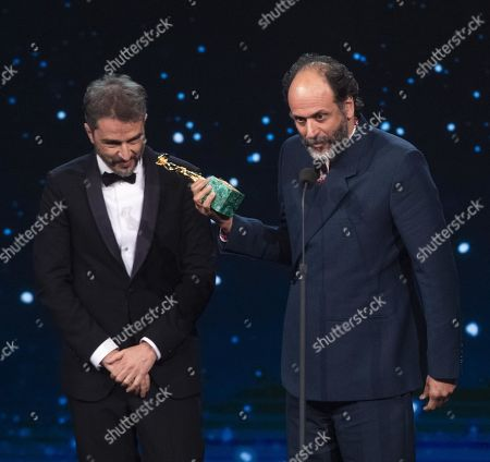 Stock Photo of Walter Fasano (L) with Italian film director Luca Guadagnino on stage in the occasion of the 64th edition of the David di Donatello Awards of the David di Donatello Awards in Rome, Italy, 27 March 2019. The David di Donatello award is a film prize presented annually to honor the best of Italian and foreign motion picture productions.