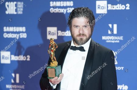 Edoardo Pesce with the award for Cinematography on the occasion of the 64th edition of the David di Donatello Awards in Rome, Italy, 27 March 2019, issued 28 March 2019. The David di Donatello award is a film prize presented annually to honor the best of Italian and foreign motion picture productions.