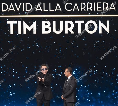 Tim Burton (L) with Italian presenter Carlo Conti on stage in the occasion of the 64th edition of the David di Donatello Awards in Rome, Italy, 27 March 2019. The David di Donatello award is a film prize presented annually to honor the best of Italian and foreign motion picture productions.