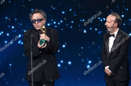 Tim Burton (L) with Italian film director and actor Roberto Benigni (R) on stage in the occasion of the 64th edition of the David di Donatello Awards in Rome, Italy, 27 March 2019. The David di Donatello award is a film prize presented annually to honor the best of Italian and foreign motion picture productions.