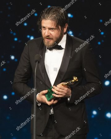Edoardo Pesce on stage in the occasion of the 64th edition of the David di Donatello Awards in Rome, Italy, 27 March 2019. The David di Donatello award is a film prize presented annually to honor the best of Italian and foreign motion picture productions.