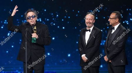 Tim Burton (L) with Italian film director and actor Roberto Benigni and Italian presenter Carlo Conti (R) on stage in the occasion of the 64th edition of the David di Donatello Awards in Rome, Italy, 27 March 2019. The David di Donatello award is a film prize presented annually to honor the best of Italian and foreign motion picture productions.